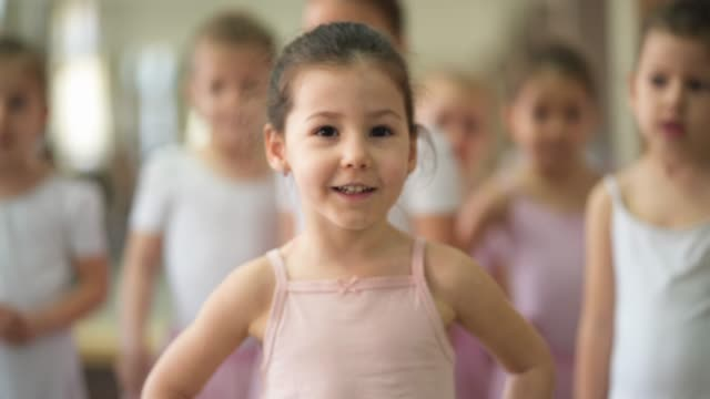 Adorable little ballerina Group of young girls practicing ballet in ballet studio leotard stock videos & royalty-free footage