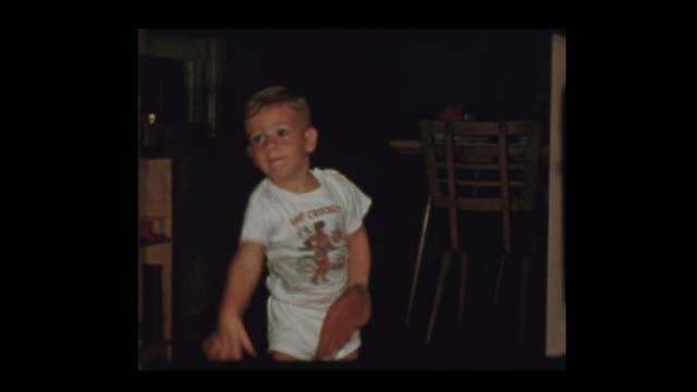Adorable little boy plays baseball inside in underwear video
