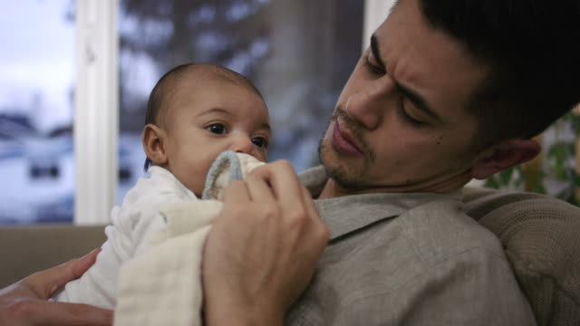 Adorable Mixed-Race Infant Resting on Her Filipino Fathers Chest video