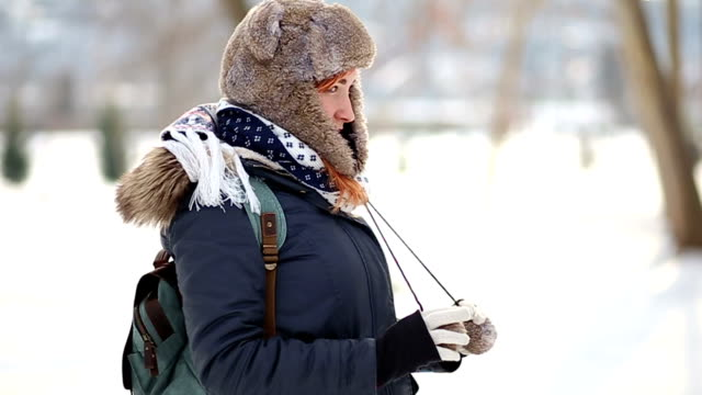 Adorable Redheaded Girl In Snowy Scenery Charming Red-haired Woman In Warm Winter Clothes Enjoying Sunny Day At Park dyed red hair stock videos & royalty-free footage