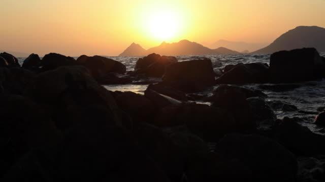 Adorable sunset at Turgutreis through Aegean islands