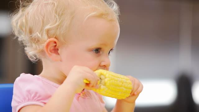 Adorable toddler eats corn video