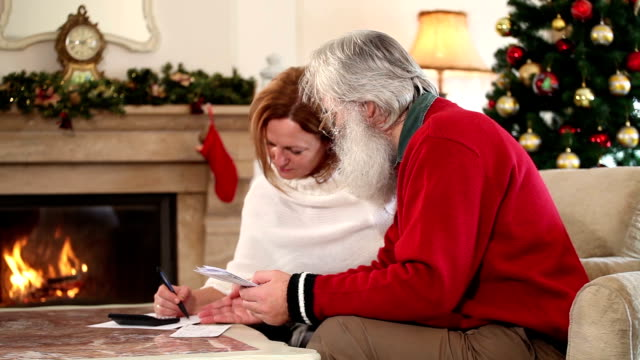 Adult couple examining financial documents video