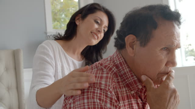 Adult Daughter Comforting Depressed Father video