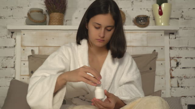 adult female taking birth-pill video