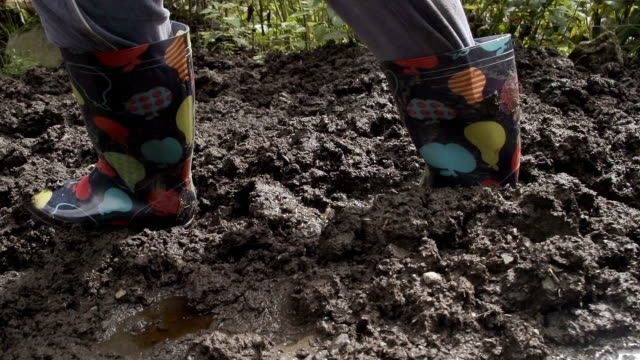 Adult Female Wearing Wellies On Muddy Ground video