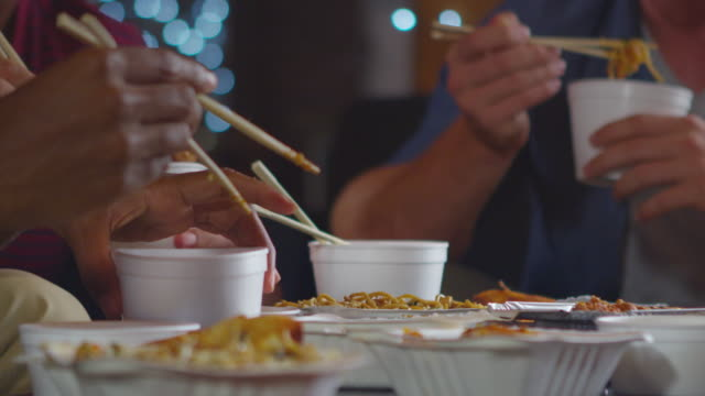 adult friends sharing a chinese take-away, close up mid section, shot on r3d - junk food stock videos and b-roll footage