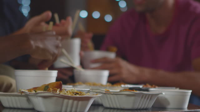 Adult friends sharing a Chinese take-away, close up mid section, shot on R3D video