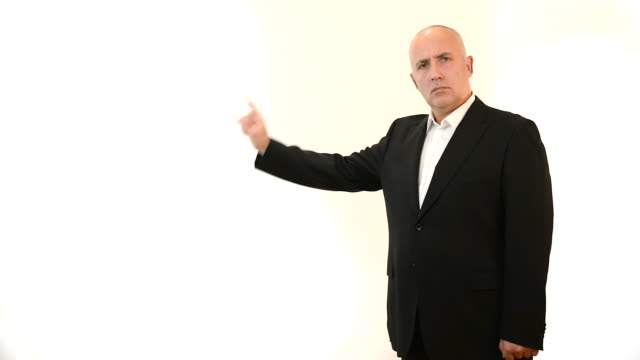 adult gray-haired man on a white background in studio. - endast en medelålders man bildbanksvideor och videomaterial från bakom kulisserna