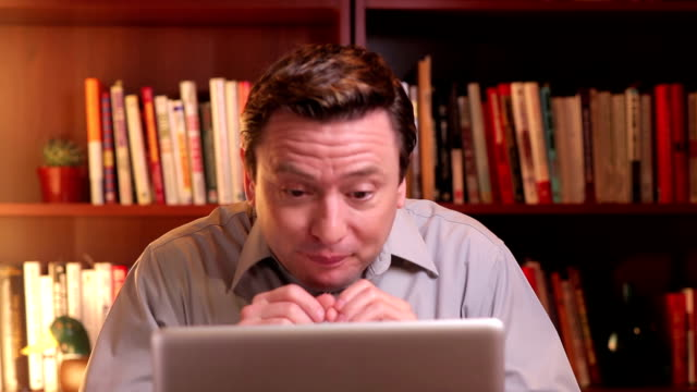 Adult making goofy faces while video chatting video