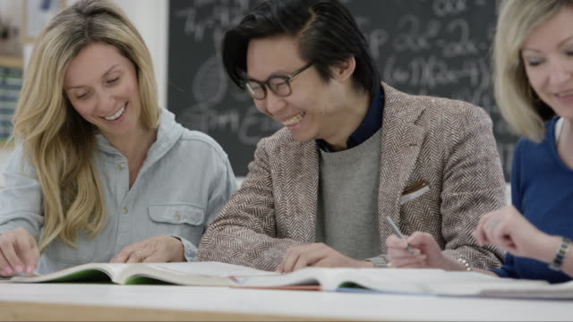 Adult Male and Female Students Study Together