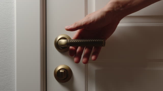 Adult Male hand opens a door handle at home Adult Male hand opens a door handle at home front view stock videos & royalty-free footage