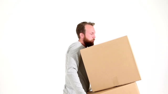 Adult Male Lifting Heavy Boxes and Injuring Back video