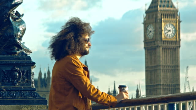 Adult  Male looking at the view at Queen's Walk and the Big Ben in London video