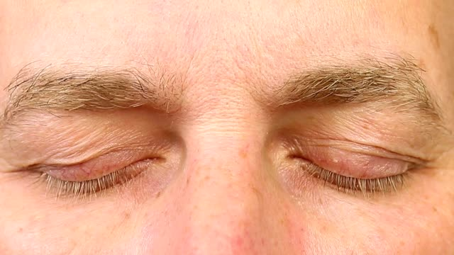 adult man blinking his eyes. extreme close-up view. human eyes fast open up and shut down. rem rapid eye movement. see dreams sleep and wake up rapidly. caucasian male face close open eyes. - поститься стоковые видео и кадры b-roll