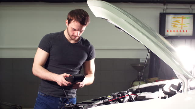 Adult Man Checks the Condition of the Vehicle in a Tire Service Shop video