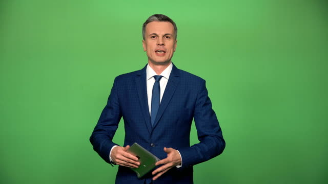 Adult man during giving news video