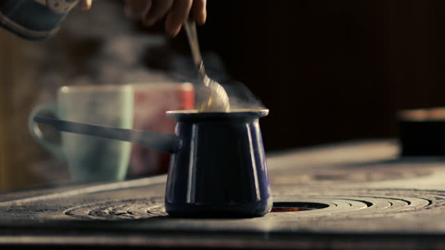 Adult Man Making Ground Coffee in Coffeepot