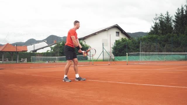 adult man practising tennis serve - target australia stock videos & royalty-free footage