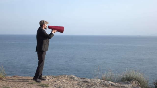 Adult Man Shouting Via Old Fashioned Megaphone In Outdoor video