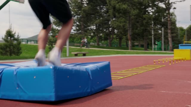 Adult man training on an outdoor obstacles course video