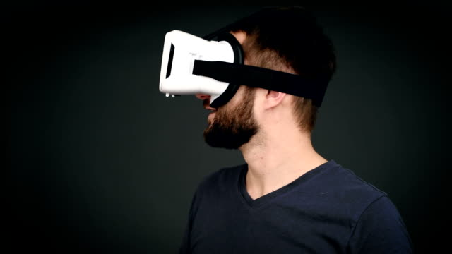 adult man using virtual reality glasses video