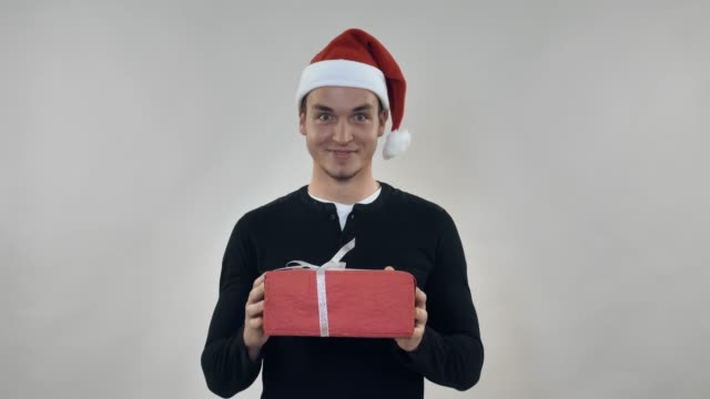 adult person with xmas present video