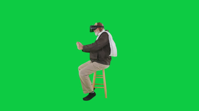 Adult senior male caucasian playing virtual reality WWi Ace wearing VR goggles