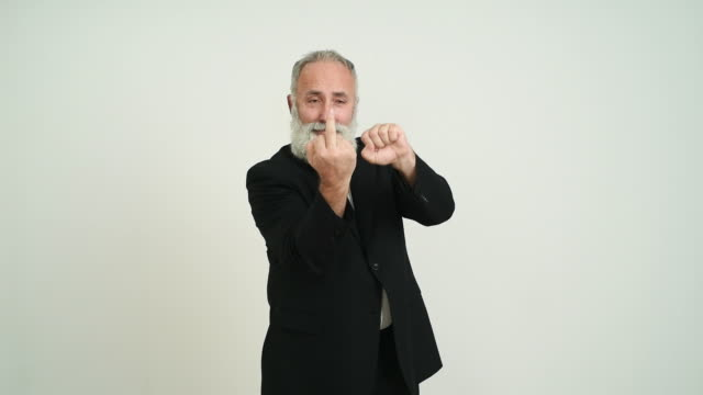 Adult senior man showing a middle finger  on a grey background video