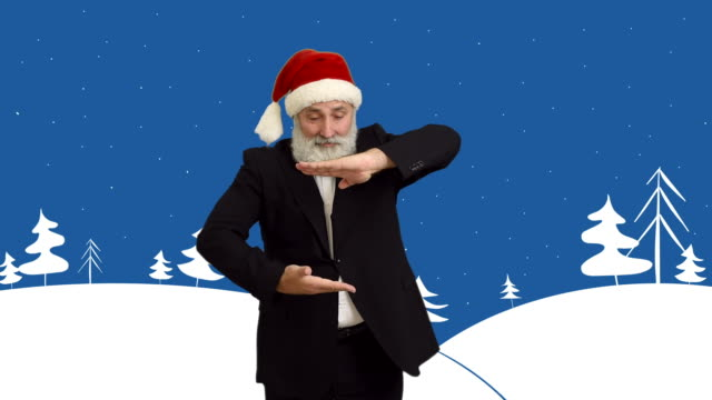 adult senior man shows copy space  in a hat santa claus  on a cartoon background on the theme of winter video