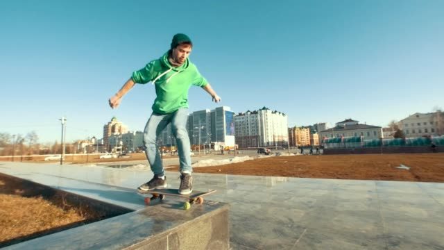 Adult skateboarder failed tricks outdoors in sunny day