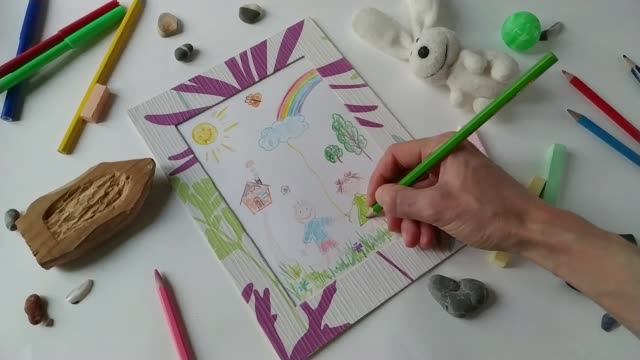 Adult woman draws children's style picture drawing