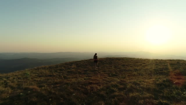 Adult Woman Running To a Top Of a Hill and Outstretching Arms video