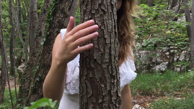 Adult Woman Tree Hugging in Forest