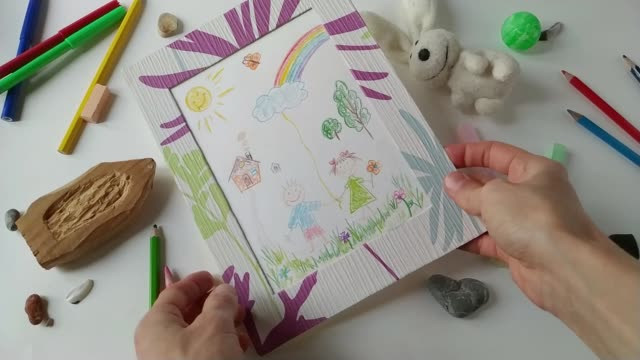 Adult woman viewing children's drawing slow motion