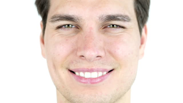 adult young man smile, after orthodontic treatment with braces video