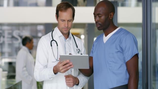 advancing through medical matters with technology - doctor filmów i materiałów b-roll