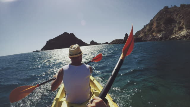 POV adventure: kayaking in a summer sea POV adventure: kayaking in a summer sea angle stock videos & royalty-free footage