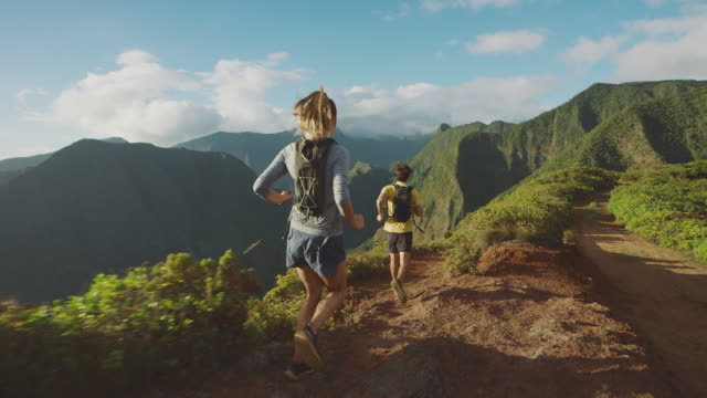Adventurous runners exploring the outdoors together video