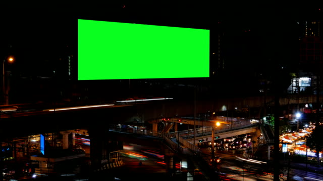 Advertising Billboard with green screen, time lapse. Advertising Billboard with green screen and traffic at night, for advertisement, time lapse. billboard stock videos & royalty-free footage