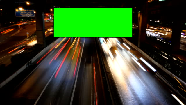 Advertising green screen with traffic at night. video