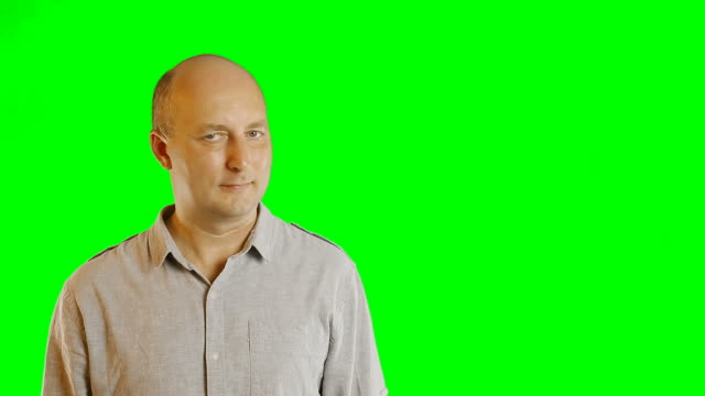 Advertising template with finger hands gestures adult men with alpha channel green screen. Adult caucasian bald man gestures. Casual shirt jeans adult men. Green screen background. Modern technology. video