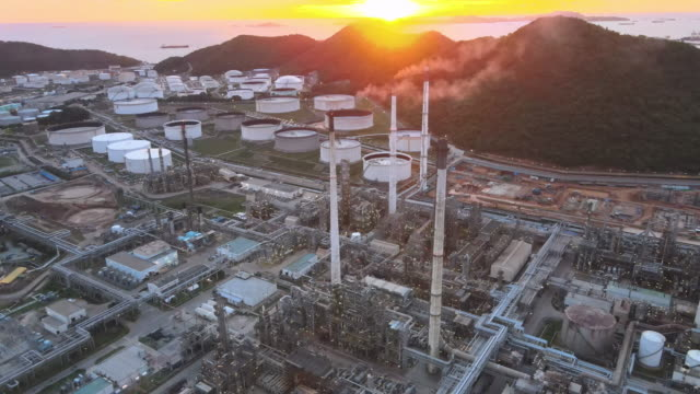 aerial 4k drone pov sunset at top down view over oil refinery or chemical factory  in south east asia - opec video stock e b–roll