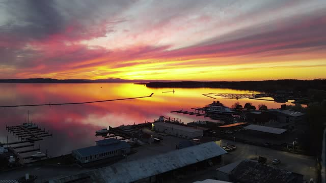 Aerial 4K drone video of spectacular sunset reflected on lake