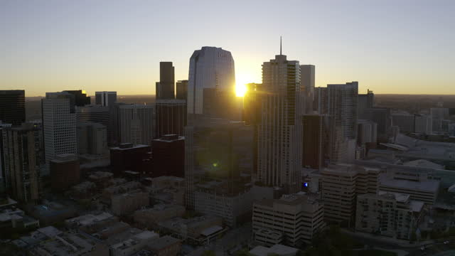 Aerial 4K HDR video of downtown Denver, Colorado at sunrise