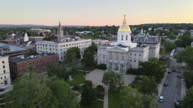 Aerial 4K video of New Hampshire State House at sunset Beautiful sunset in Concord, NH over the state capitol building. Drone shot flying right as drone circles around building. american architecture stock videos & royalty-free footage