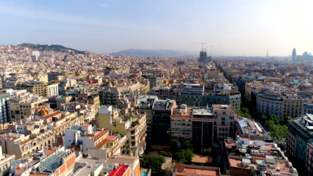 Aerial above Barcelona Eixample district rooftops, morning light, Spain video