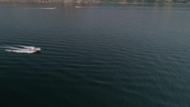 Aerial Above Boat Passing on Sunny Summer Day in Boating Season video