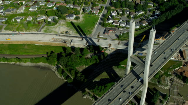Aerial above view Alex Fraser Bridge, Vancouver Aerial above view Alex Fraser Bridge cabled stayed bridge over Fraser River, North Delta, Vancouver, BC, Canada fraser river stock videos & royalty-free footage