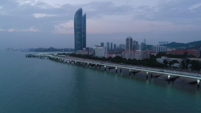 antenn över utsikt över xiamen china cityscape på kvällen - xiamen bildbanksvideor och videomaterial från bakom kulisserna